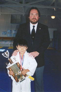 Instructor Alain Wilkinson and student Daniel Kodama after winning a trophy in Dec 2002